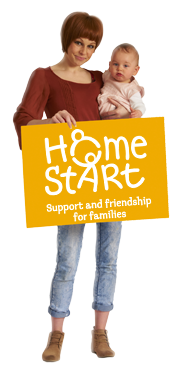 Mother with a baby and holding a Home-Start card.
