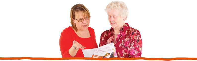 Home-Start trustees reviewing a leaflet.